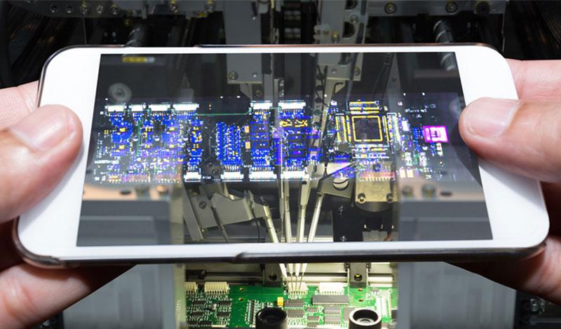 Semiconductors shown through a phone screen