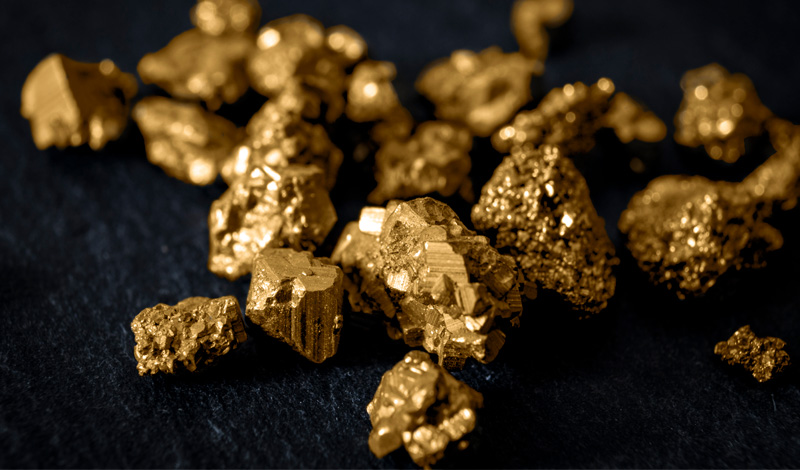 Nuggets of gold on a black background